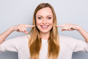 woman pointing smile