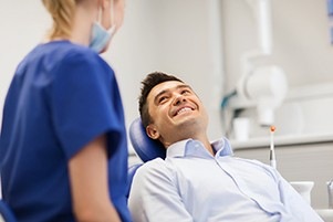 Man smiling at dentist after root canal therapy in Wharton
