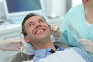 man happy in dental chair